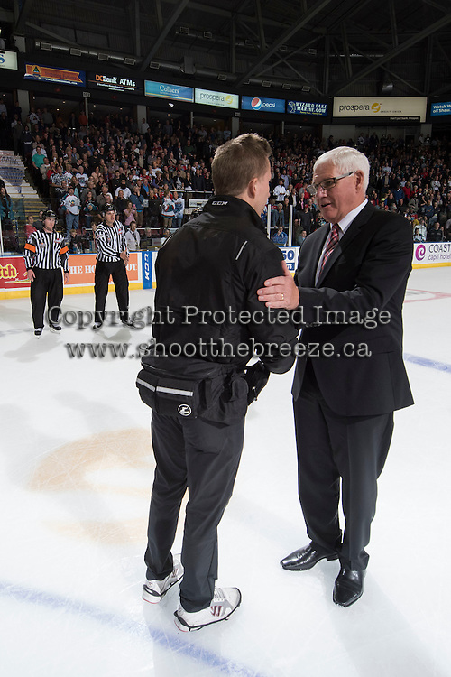 KELOWNA, CANADA - MAY 13: The Kelowna Rockets shake hands with the Brandon Wheat Kings on May 13, 2015 during game 4 of the WHL final series at Prospera Place in Kelowna, British Columbia, Canada.  (Photo by Marissa Baecker/Shoot the Breeze)  *** Local Caption ***