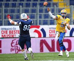 01.06.2014, NV Arena, St. Poelten, AUT, American Football Europameisterschaft 2014, Gruppe A, Finnland (FIN) vs Schweden (SWE), im Bild Lauri Vainio, (Team Finland, DL, #92) und  Anders Hermodsson, (Team Sweden, QB, #5) // during the American Football European Championship 2014 group A game between Finland and Sweden at the NV Arena, St. Poelten, Austria on 2014/06/01. EXPA Pictures © 2014, PhotoCredit: EXPA/ Thomas Haumer