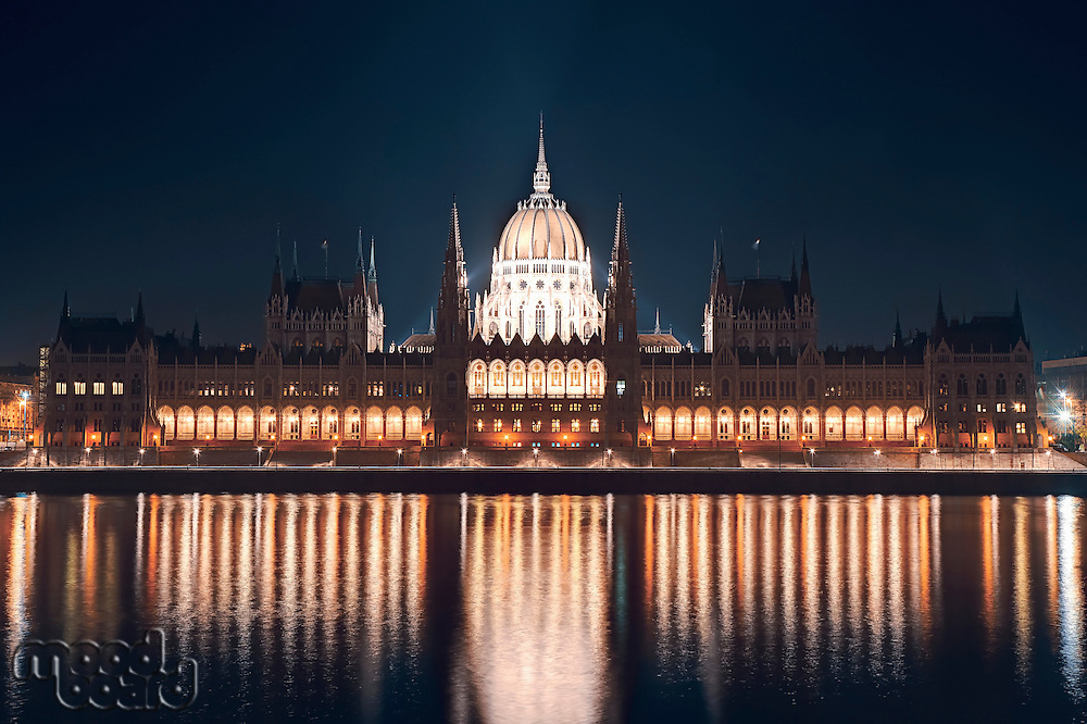 Night cityscape of the Parliament building on the Danube riverbank in central Budapest  capital of Hungary