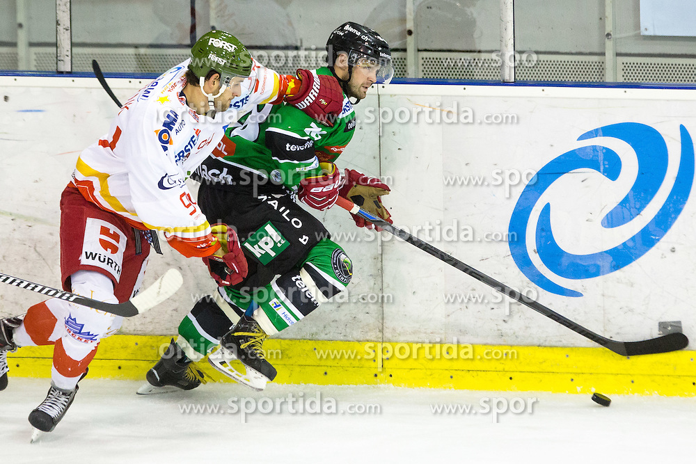 23.10.2014, Hala Tivoli, Ljubljana, SLO, EBEL, HDD Telemach Olimpija Ljubljana vs HC Bolzano Südtirol, 13. Runde, in picture Andrej Hebar (HDD Telemach Olimpija, #28) vs Daniel Frank (HC Bolzano Sudtirol, #94) during the Erste Bank Icehockey League 13. Round between HDD Telemach Olimpija Ljubljana and  HC Bolzano Südtirol at the Hala Tivoli, Ljubljana, Slovenia on 2014/10/23. Photo by Matic Klansek Velej / Sportida