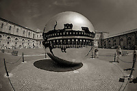 ROME, ITALY - JUNE 03: Illustration of Rome; Italy on June 03, 2012..The treasures of the Vatican. Sfera Con Sfera. Pomodoro..Sphere Within Sphere is a bronze sculpture, by Italian sculptor, Arnaldo Pomodoro. Versions of the sculpture can be seen in the Vatican Museums and the Palazzo della Farnesina in Rome, Trinity College Dublin, the United Nations Headquarters in New York, the Hirshhorn Museum and Sculpture Garden in Washington D.C.,  Christian Theological Seminary in Indianapolis, the Columbus Museum of Art in Columbus, Ohio, the de Young Museum in San Francisco, Tehran Museum of Contemporary Art in Tehran,the Des Moines Art Center in Des Moines, the Hakone Open-Air Museum of Japan, the University of California, Berkeley and the Tel aviv University in Israel. Pomodoro designed a controversial fiberglass crucifix for the Cathedral of St. John the Evangelist in Milwaukee, Wisconsin. The piece is topped with a fourteen foot in diameter crown of thorns which hovers over the figure of Christ.