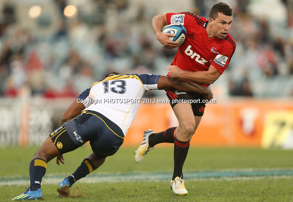 Crusaders' Tom Marshall is tackled.  Brumbies v Crusaders. 2013 Investec Super Rugby Season. Canberra Stadium, Canberra, Australia.  Sunday 5 May 2013. Photo: Mark Metcalfe/Photosport.co.nz
