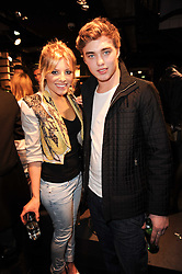 MOLLIE KING from The Saturdays and ALEX GARDNER at the Lee store re-launch party held at 13-14 Carnaby Street, London on 31st March 2010. MOLLIE KING