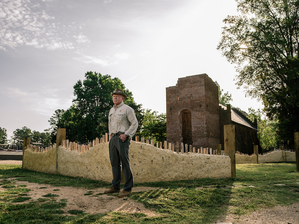 "Jamestown lead archaeologist William Kelso stands outside the walls of what explorer John Smith called the ""golden church,"" the first Protestant church in the Americas."