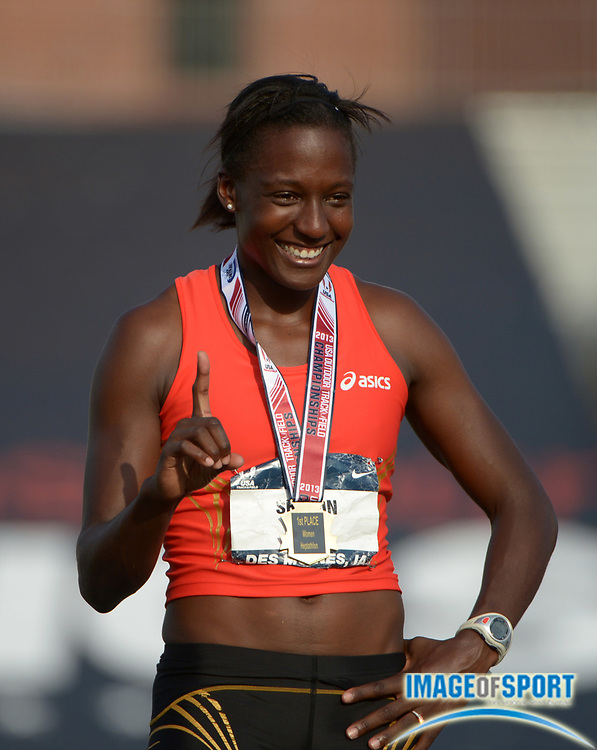 Jun 21, 2013; Des Moines, IA, USA; Sharon Day poses after winning the heptathlon with 6,550 points in the 2013 USA Championships at Drake Stadium.