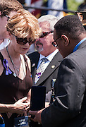 "Maura Kelley with Ventura County Senior Deputy Patrick Hawthorne receive a medal of Valor during the 34th Annual National Peace Officers Memorial Service to remember her late husband Ventura County sheriff's deputy Yehven ""Eugene"" Kostiuchenko at the west lawn of the U.S. Capitol on May 15, 2015. Yehven, a Ukrainian hit by a drunk driver last October who came to the U.S. to investigate a money laundering case and met his future wife. Photo by Kris Connor"