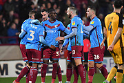 Scunthorpe united celebrate goal scored by Scunthorpe United player Kgosi Ntlhe (3) to go 2-1 during the EFL Sky Bet League 2 match between Scunthorpe United and Port Vale at Glanford Park, Scunthorpe, England on 23 November 2019.