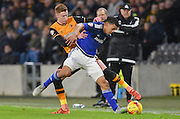 Hull City midfielder Sam Clucas (11) tries to get to ball past Lee Peltier of Cardiff City  during the Sky Bet Championship match between Hull City and Cardiff City at the KC Stadium, Kingston upon Hull, England on 13 January 2016. Photo by Ian Lyall.