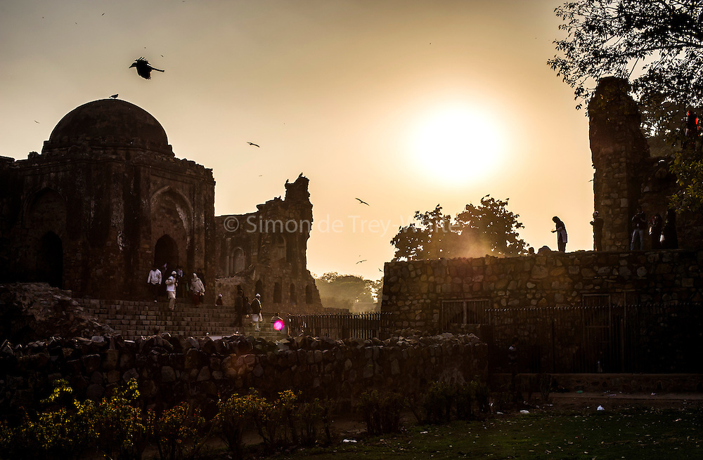 29th January 2015, New Delhi, India. View of the ruins of Feroz Shah Kotla as believers move through them praying, making offerings and asking for their wishes to be granted by Djinns in the ruins of Feroz Shah Kotla in New Delhi, India on the 29th January 2015<br /> <br /> PHOTOGRAPH BY AND COPYRIGHT OF SIMON DE TREY-WHITE a photographer in delhi. + 91 98103 99809. Email:simon@simondetreywhite.com<br /> <br /> People have been coming to Firoz Shah Kotla to leave written notes and offerings for Djinns in the hopes of getting wishes granted since the late 1970's. Jinn, jann or djinn are supernatural creatures in Islamic mythology as well as pre-Islamic Arabian mythology. They are mentioned frequently in the Quran  and other Islamic texts and inhabit an unseen world called Djinnestan. In Islamic theology jinn are said to be creatures with free will, made from smokeless fire by Allah as humans were made of clay, among other things. According to the Quran, jinn have free will, and Iblīs abused this freedom in front of Allah by refusing to bow to Adam when Allah ordered angels and jinn to do so. For disobeying Allah, Iblīs was expelled from Paradise and called &quot;Shayṭān&quot; (Satan).They are usually invisible to humans, but humans do appear clearly to jinn, as they can possess them. Like humans, jinn will also be judged on the Day of Judgment and will be sent to Paradise or Hell according to their deeds. Feroz Shah Tughlaq (r. 1351&ndash;88), the Sultan of Delhi, established the fortified city of Ferozabad in 1354, as the new capital of the Delhi Sultanate, and included in it the site of the present Feroz Shah Kotla. Kotla literally means fortress or citadel.