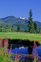 Whistler Mountain is reflected in the pond at the sixth hole on the Whistler Golf course, Whistler, BC Canada.