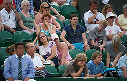 LONDON, ENGLAND - Monday, June 27, 2011: Spectators find the match tough going during the Gentlemen's Singles 4th Round match on day seven of the Wimbledon Lawn Tennis Championships at the All England Lawn Tennis and Croquet Club. (Pic by David Rawcliffe/Propaganda)