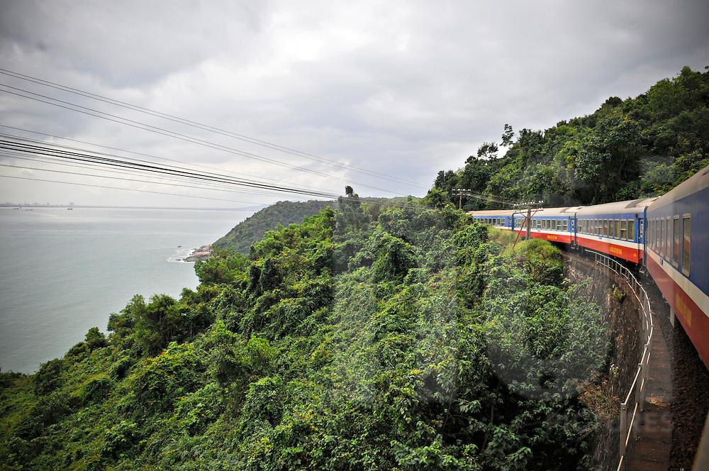 Train crosses a jungle landscape between Hue and Danang at the Pass of Ocean Clouds - Hai Van Pass, Vietnam, Southeast Asia