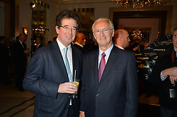 Left to right, LORD GRIMTHORPE and LOUIS ROMANET Chairman of the IFHA at the Longines World's Best Racehorse Awards 2014 hosted by Longines and the International Federation of Horseracing Authorities held at Claridge's, Brook Street, London on 20th January 2015.