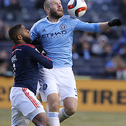 Adam Nemec, (right), NYCFC, is challenged by Andrew Farrell, New England Revolution, during the New York City FC v New England Revolution, inaugural MSL football match at Yankee Stadium, The Bronx, New York,  USA. 15th March 2015. Photo Tim Clayton