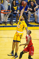 Feb 18, 2017; Morgantown, WV, USA; West Virginia Mountaineers forward Esa Ahmad (23) dunks the ball during the first half against the Texas Tech Red Raiders at WVU Coliseum. Mandatory Credit: Ben Queen-USA TODAY Sports