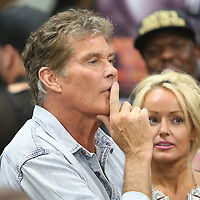 LAS VEGAS, NV - APRIL 14: Actor David Hasselhoff and Hayley Roberts (R) are seen ringside at a workout by WBC/WBA welterweight champion Floyd Mayweather Jr. at the Mayweather Boxing Club on April 14, 2015 in Las Vegas, Nevada. Mayweather will face WBO welterweight champion Manny Pacquiao in a unification bout on May 2, 2015 in Las Vegas.  (Photo by Alex Menendez/Getty Images) *** Local Caption *** David Hasselhoff, Hayley Roberts