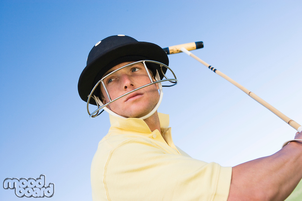 Polo player preparing to swing