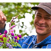 Organic flower grower Shane Eby with a bouquet.