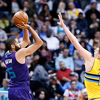 04 March 2017: Charlotte Hornets guard Nicolas Batum (5) takes a jump shot over Denver Nuggets forward Nikola Jokic (15) during the Charlotte Hornets 112-102 victory over the Denver Nuggets, at the Pepsi Center, Denver, Colorado, USA.