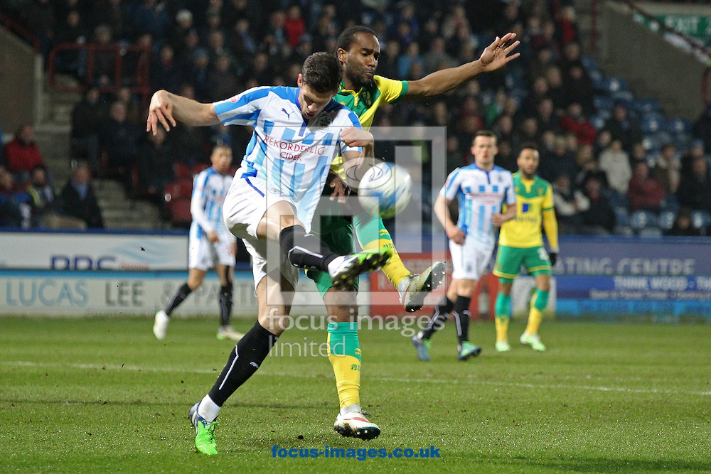 Tommy Smith of Huddersfield Town and Cameron Jerome of Norwich in action during the Sky Bet Championship match at the John Smiths Stadium, Huddersfield<br /> Picture by Paul Chesterton/Focus Images Ltd +44 7904 640267<br /> 17/03/2015