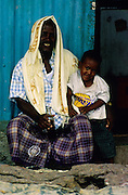 Djibouti. Little boy and his father.