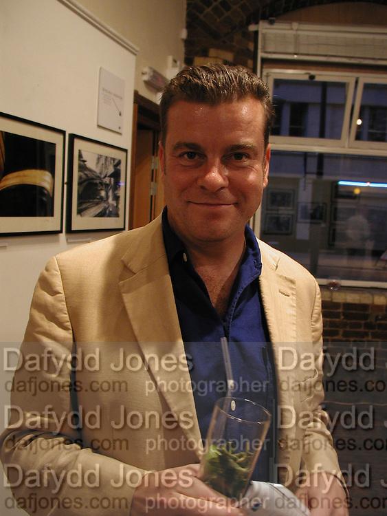 Steven Heffer opening. Menier Gallery, Southwark St. London. 4 September 2002. © Copyright Photograph by Dafydd Jones 66 Stockwell Park Rd. London SW9 0DA Tel 020 7733 0108 www.dafjones.com