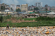 Dar es Salaam, Tanzania - 2015-05-24 - Men sort flooding waste washed downstream in Jangwani in Dar es Salaam, Tanzania on May 24, 2015.  Photo by Daniel Hayduk