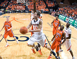 Virginia guard Sammy Zeglinski (13) finishes a reverse layup against Clemson.  The Virginia Cavaliers defeated the #12 ranked Clemson Tigers in overtime 85-81 at the John Paul Jones Arena on the Grounds of the University of Virginia in Charlottesville, VA on February 15, 2009.