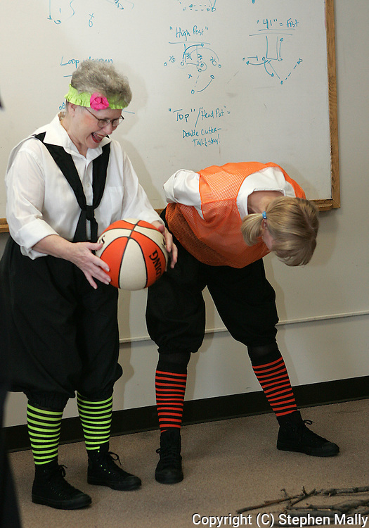 Cedar Rapids Sizzlers' Betty Vieman (left), age 73, and Robins Late Bloomer's Susie Demar (right), age 54, stretch during warmup before their game at Coe College on February 14, 2007.