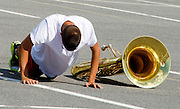 Photo by Phil Grout..It is hoped that mandatory push-ups for missteps and miscues will sharpen the skills of the band members.