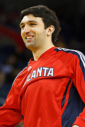 February 25, 2011; Oakland, CA, USA;  Atlanta Hawks center Zaza Pachulia (27) warms up before the game against the Golden State Warriors at Oracle Arena. Atlanta defeated Golden State 95-79.