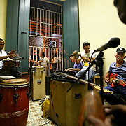 A cuban band practices in one of the many community art centers while passers-by stop to enjoy the music. Cuban's are very proud of their musical style, which is a unique blend of Spanish, European, African, and Latin music coupled with Cuba's native style, called Son. ltqmb BAND PRACTICE