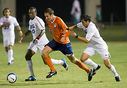 Southern Methodist Mustangs defender Leone Cruz (5) tries to slow Virginia Cavaliers midfielder/defender Jordan Evans (2).  The #18 ranked Virginia Cavaliers fell to the #14 ranked Southern Methodist Mustangs 3-1 in NCAA men's soccer at Klockner Stadium on the Grounds of the University of Virginia in Charlottesville, VA on August 31, 2008.