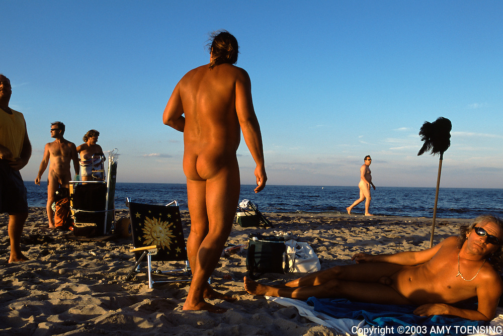 SANDY HOOK, NJ - JULY 13: Visitors hang out on the clothing optional area of Gunnison Beach, July 12, 2003, Sandy Hook, New Jersey. Gunnison is part of the Gateway National Recreational Area and has been a destination for nudists since the 1970s. Many of its visitors have been enjoying the sun and socializing there since its beginning. The Jersey Shore, a 127 mile stretch of coastline known for its variety of beaches, boardwalks, small towns, natural beauty and summer crowds, has been a popular summer destination for over a century. (Photo By Amy Toensing)