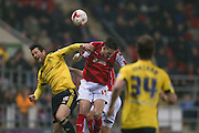 Middlesbrough forward David Nugent (35) and Rotherham United defender Greg Halford (15) challenge in the air  during the Sky Bet Championship match between Rotherham United and Middlesbrough at the New York Stadium, Rotherham, England on 8 March 2016. Photo by Simon Davies.