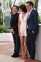 Producer Thomas Langmann , Actress Bérénice Bejo, director Michel Hazanavicius, at the photo call for the film The Search at the 67th Cannes Film Festival, Wednesday 21st  May 2014, Cannes, France.