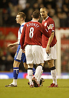 Photo: Aidan Ellis.<br /> Manchester United v Portsmouth. The FA Cup. 27/01/2007.<br /> United's Rio Ferdinand lokks at Wayne Rooney in fuuny manner after his second Wonder goal