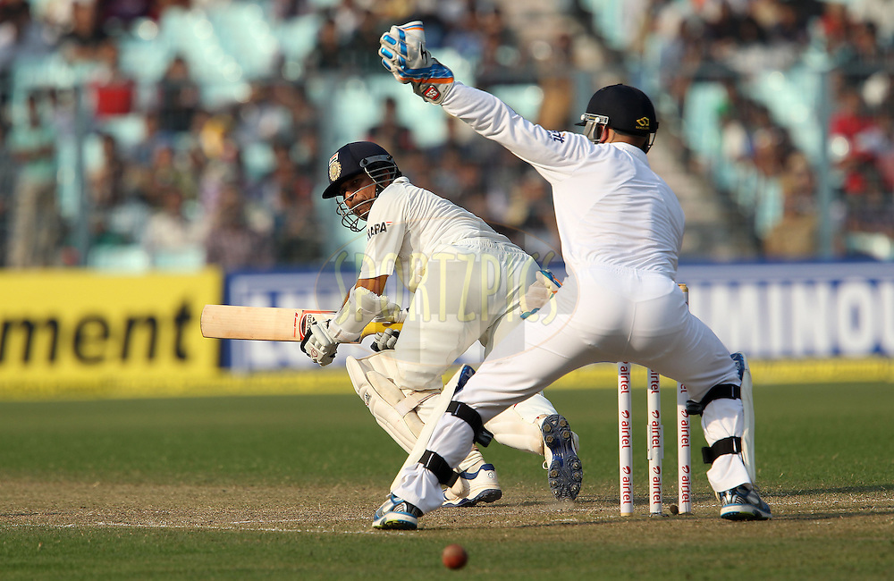 Sachin Tendulkar of India slides the ball through for four during day one of the 3rd Airtel Test Match between India and England held at Eden Gardens in Kolkata on the 5th December 2012..Photo by Ron Gaunt/BCCI/SPORTZPICS ..Use of this image is subject to the terms and conditions as outlined by the BCCI. These terms can be found by following this link:..http://www.sportzpics.co.za/image/I0000SoRagM2cIEc