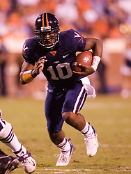 Virginia quarterback Jameel Sewell (10) rushes against Pitt.  The Virginia Cavaliers faced the Pittsburgh Panthers at Scott Stadium in Charlottesville, VA on September 29, 2007.