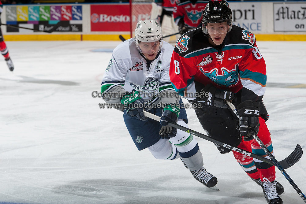 KELOWNA, CANADA - DECEMBER 7: Scott Eansor #8 of the Seattle Thunderbirds stick checks Jack Cowell #8 of the Kelowna Rockets during first period on December 7, 2016 at Prospera Place in Kelowna, British Columbia, Canada.  (Photo by Marissa Baecker/Shoot the Breeze)  *** Local Caption ***
