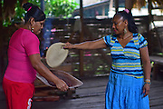 Virgilia and Kathiana preparing natural cacao drink at Bribri tribe house. <br /> <br /> A day with the Bribri, indigenous people in Lim&oacute;n Province of Costa Rica.