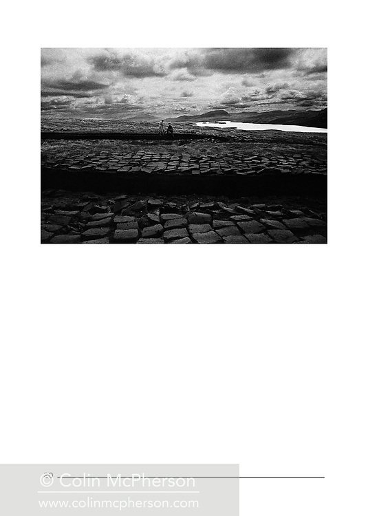 'An Independent Eye', a photo book published in 2016. <br /> <br /> It was published to mark the end of print publishing of the Independent and Independent on Sunday newspapers, who I had worked for as a freelance on assignments and commissions from 1995 until 2016.<br /> <br /> Photo shows: Peat cutters, Lewis, 1997.<br /> <br /> It was self-published the same year in an edition of 250.