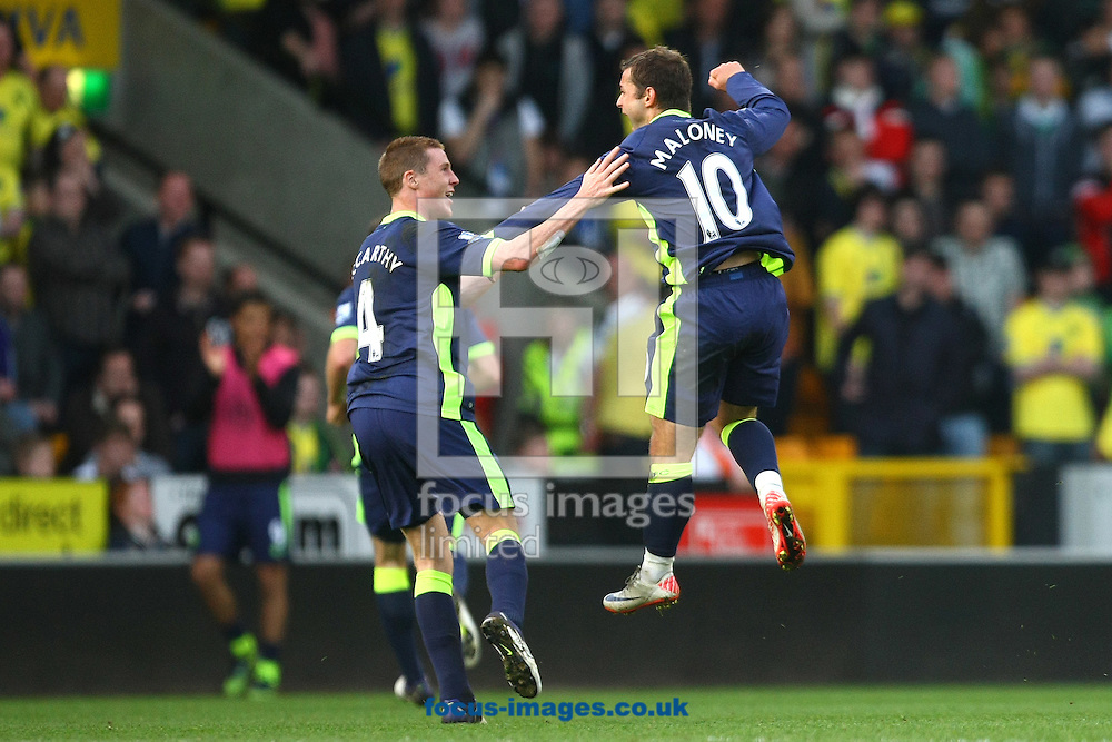 Picture by Paul Chesterton/Focus Images Ltd.  07904 640267.11/03/12.Shaun Maloney of Wigan and James McCarthy of Wigan celebrate their side's equalising goal during the Barclays Premier League match at Carrow Road Stadium, Norwich.