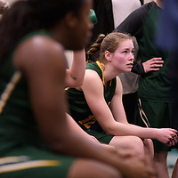 4th year forward Christina McCusker (12) of the Regina Cougars in action during the Women's Basketball Playoff Game on February  16 at Centre for Kinesiology, Health and Sport. Credit: Arthur Ward/Arthur Images
