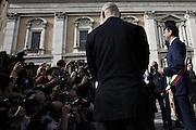 Una guardia del corpo osserva Ignazio Marino posare davanti ai fotografi per il primo scatto ufficiale come Sindaco di Roma dopo la sua elezione<br /> Roma - Piazza del Campidoglio 27 giugno 2013. Matteo Ciambelli / OneShot