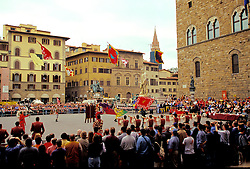 Florence, Italy:  Flag drill teams representing the city's neighborhoods and outlying Tuscany towns compete in late Spring in the Piazza della Signoria.