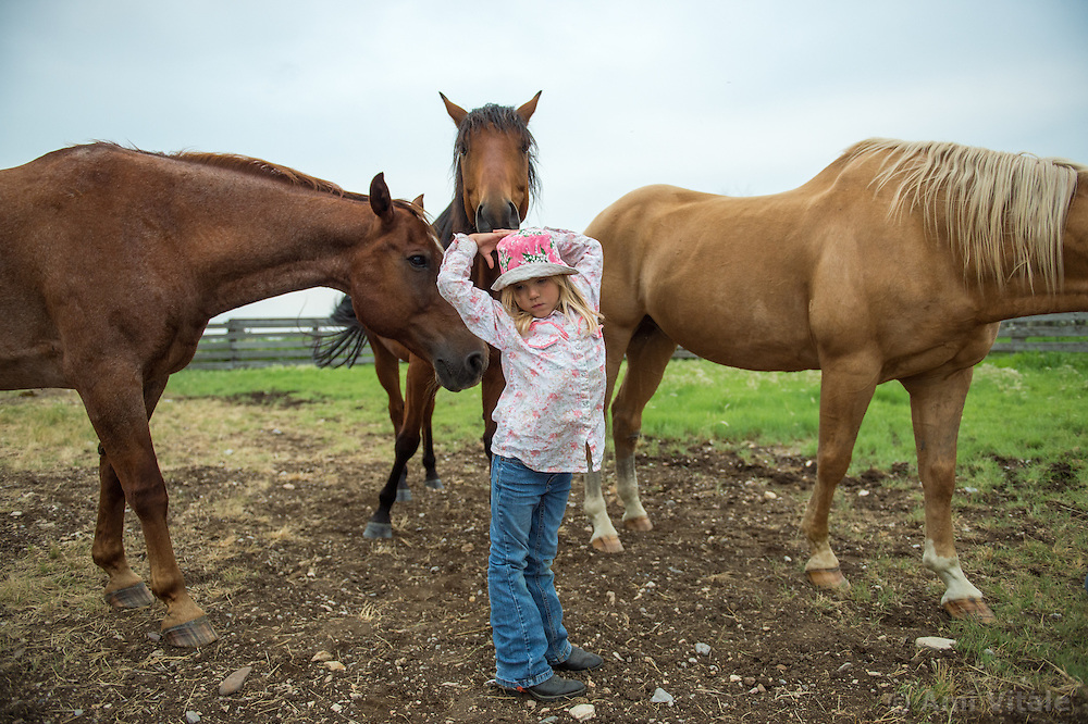 The Nature Conservancy's Matador Ranch Operations Manager Charlie Messerly's daughter Layla plays with her horse in Eastern Montana  at the Matador ranch &quot;grass bank&quot;. The &ldquo;grass bank&quot; is an innovative way to leverage conservation gains, in which ranchers can graze their cattle at discounted rates on Conservancy land in exchange for improving conservation practices on their own &ldquo;home&rdquo; ranches. In 2002, the <br /> Conservancy began leasing parts of the ranch to neighboring ranchers who were suffering from  severe drought, offering the Matador&rsquo;s grass to neighboring ranches in exchange for their  participation in conservation efforts. The grassbank has helped keep ranchers from plowing up native grassland to farm it; helped remove obstacles to pronghorn antelope migration; improved habitat for the Greater Sage-Grouse and reduced the risk of Sage-Grouse colliding with fences; preserved prairie dog towns and prevented the spread of noxious weeds. (Photo By Ami Vitale) sits on her horse in Eastern Montana  at the Matador ranch &quot;grass bank&quot;. The &ldquo;grass bank&quot; is an innovative way to leverage conservation gains, in which ranchers can graze their cattle at discounted rates on Conservancy land in exchange for improving conservation practices on their own &ldquo;home&rdquo; ranches. In 2002, the <br /> Conservancy began leasing parts of the ranch to neighboring ranchers who were suffering from  severe drought, offering the Matador&rsquo;s grass to neighboring ranches in exchange for their  participation in conservation efforts. The grassbank has helped keep ranchers from plowing up native grassland to farm it; helped remove obstacles to pronghorn antelope migration; improved habitat for the Greater Sage-Grouse and reduced the risk of Sage-Grouse colliding with fences; preserved prairie dog towns and prevented the spread of noxious weeds. (Photo By Ami Vitale)
