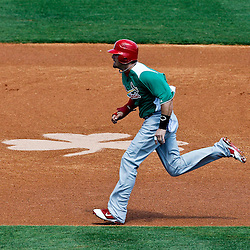 March 17, 2012; Lakeland, FL, USA; St. Louis Cardinals second baseman Tyler Greene (27) runs past a shamrock on the infield during the top of the first inning of a spring training game against the Detroit Tigers at Joker Marchant Stadium. Both teams wore green jerseys and the field was marked with shamrocks for the St. Patrick's Day game. Mandatory Credit: Derick E. Hingle-US PRESSWIRE