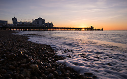 © Licensed to London News Pictures. 30/10/2017. Southsea, UK.  Dawn breaks as the sun rises into the clear sky during a chilly morning at Southsea pier this morning, 30th October 2017.  Photo credit: Rob Arnold/LNP