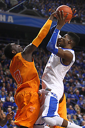 UK forward Nerlens Noel, right, has his shot contested by Tennessee center Yemi Makanjuola in the first half. The University of Kentucky Men's Basketball team hosted University of Tennessee , Tuesday, Jan. 15, 2013 at Rupp Arena in Lexington . Photo by Jonathan Palmer/Special to the Courier-Journal